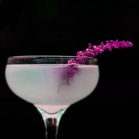 Cocktail with purple flowers
