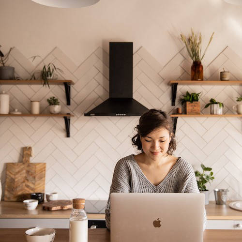 Woman working on laptop at table