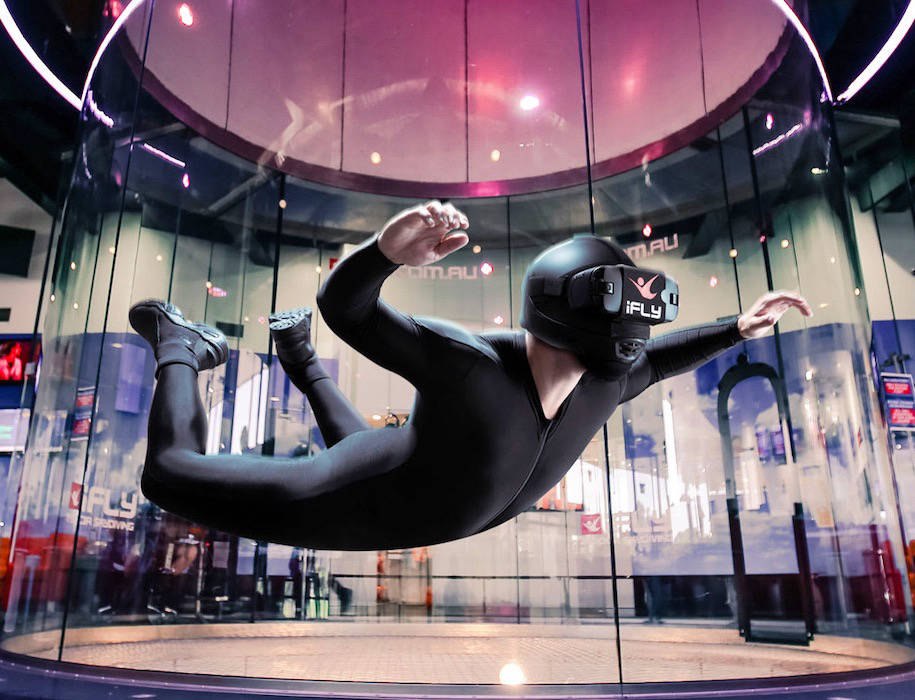 Person in an indoor skydiving wind tunnel
