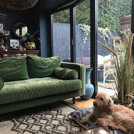 Green sofa by French sliding doors