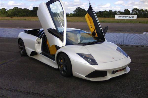 White Ferrari with scissor doors
