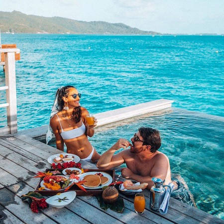 Romantic breakfast at an overwater bungalow