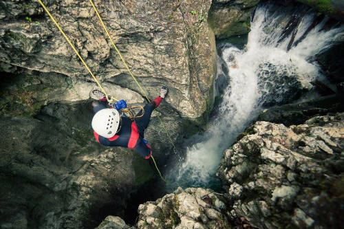 person canyoning in slovenia