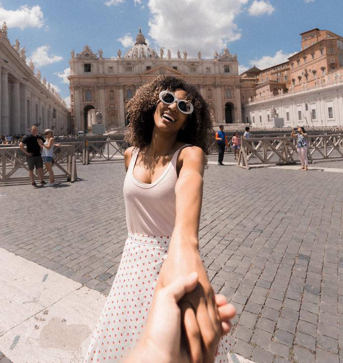 Woman holding hand of photographer