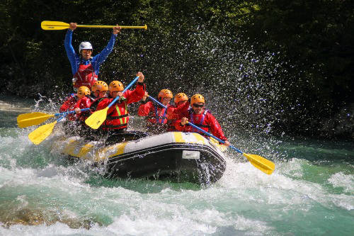 people river rafting in slovenia