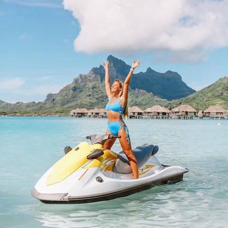 Jetski in Bora Bora with overwater bungalows