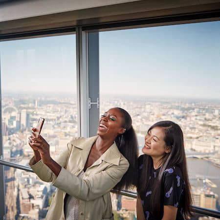 Two women taking a selfie on The Shard in London