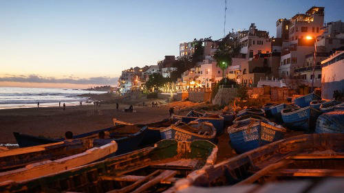 Taghazout beach and city view at sunset
