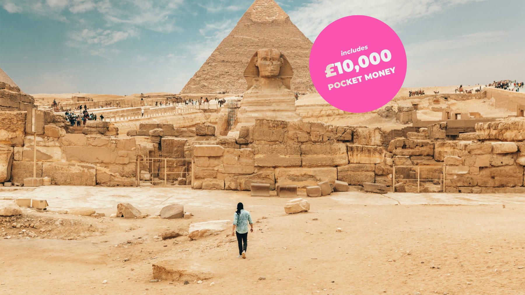 Man walking toward the pyramids in Egypt