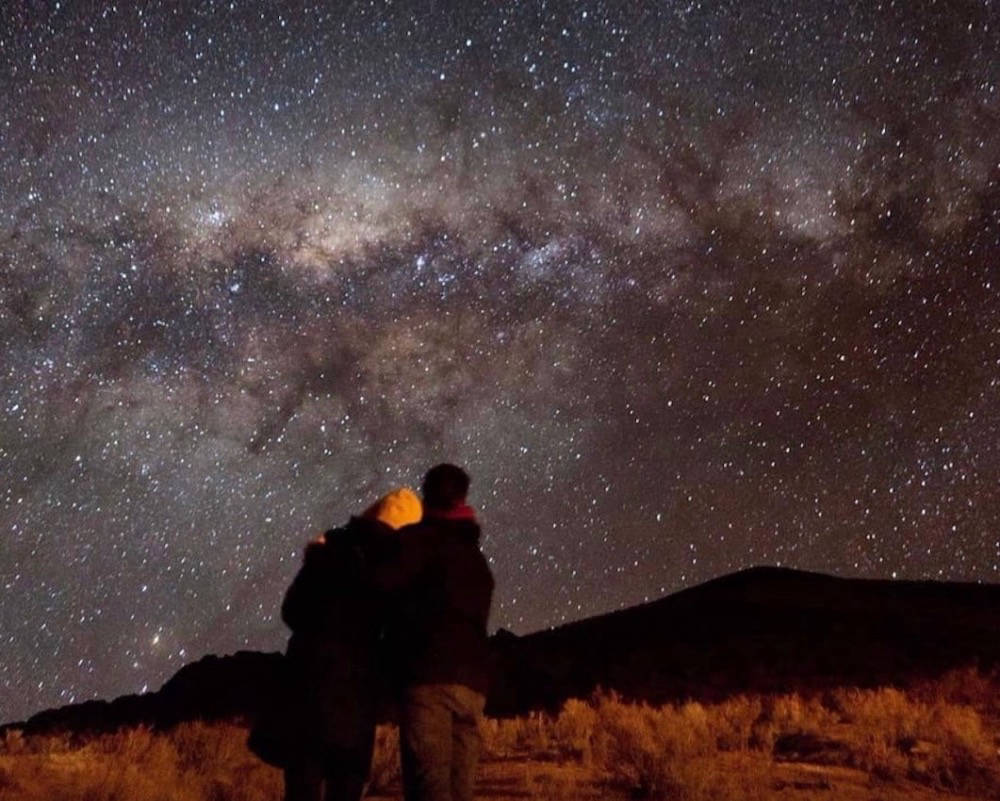 Couple stargazing in Chile
