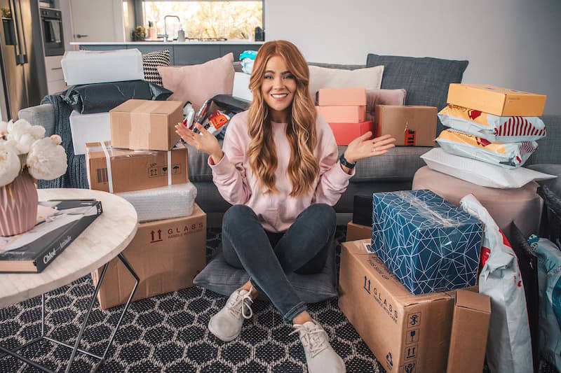 Woman surrounded by boxes and gifts