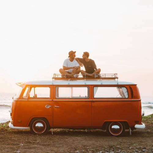 Two men sat on top of a VW Campervan