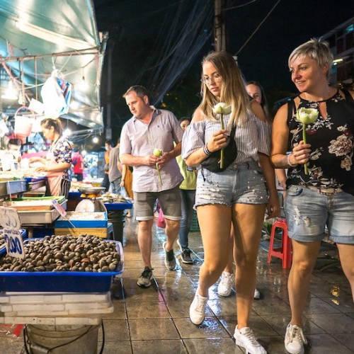 Couple walking through a street food market
