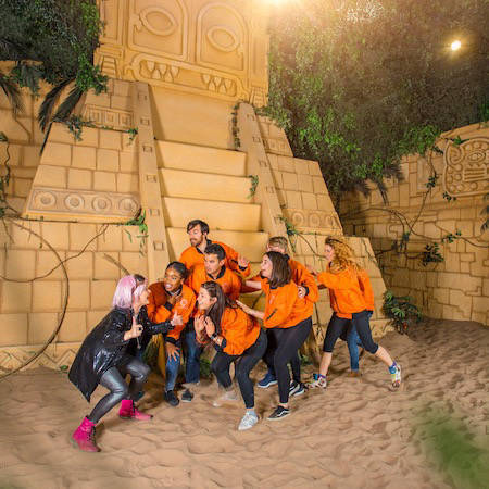 Group working together in the Crystal Maze LIVE