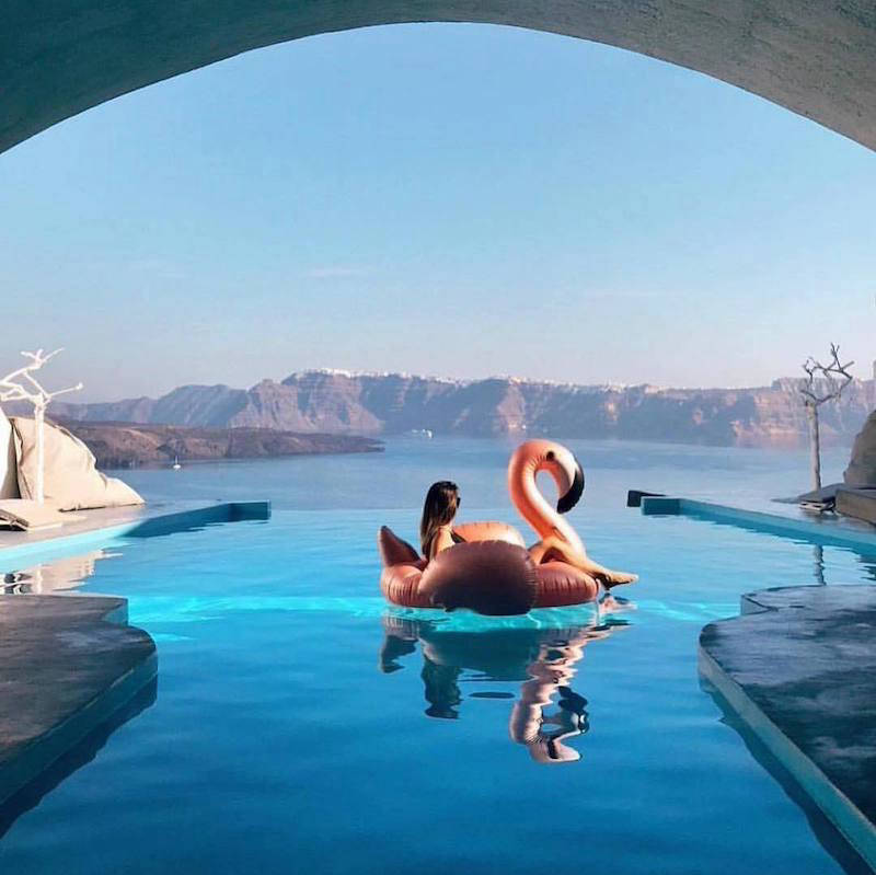 Inflatable flamingo in an infinity pool