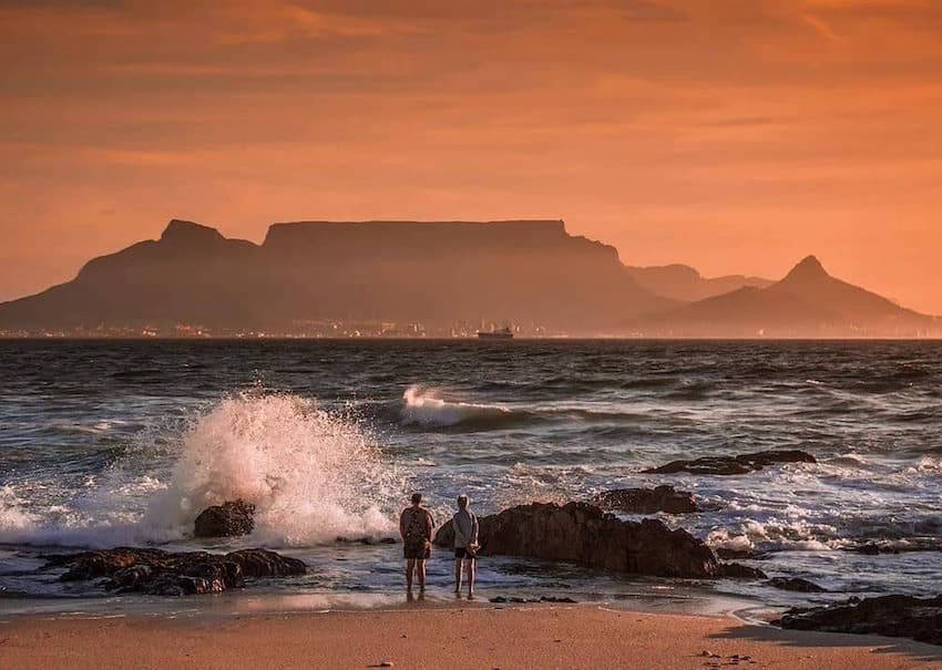 Couple overlooking the water in South Africa