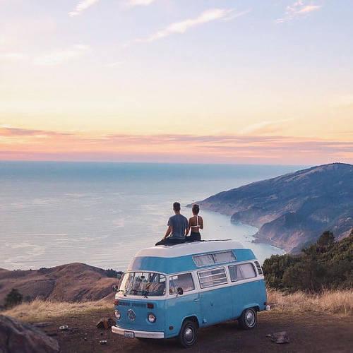 Couple on top of a Volkswagen van