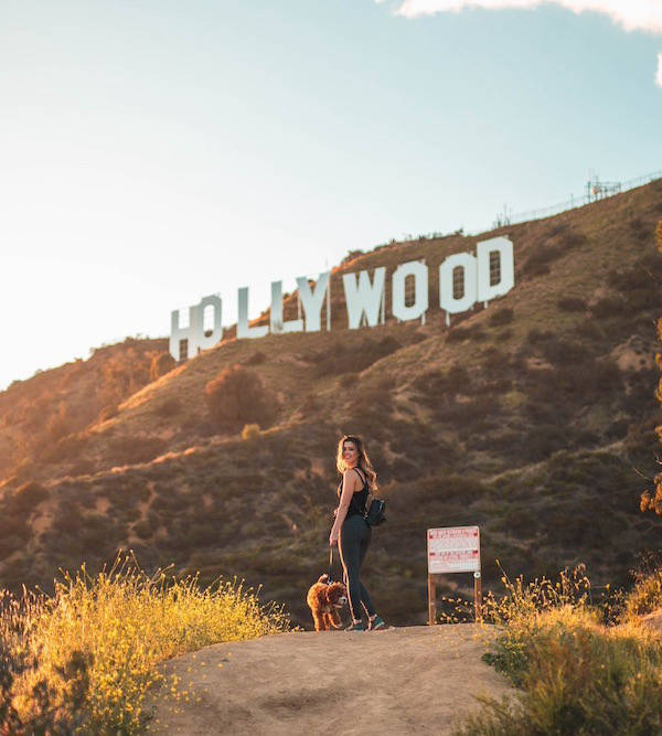 Woman in front of Hollywood sign