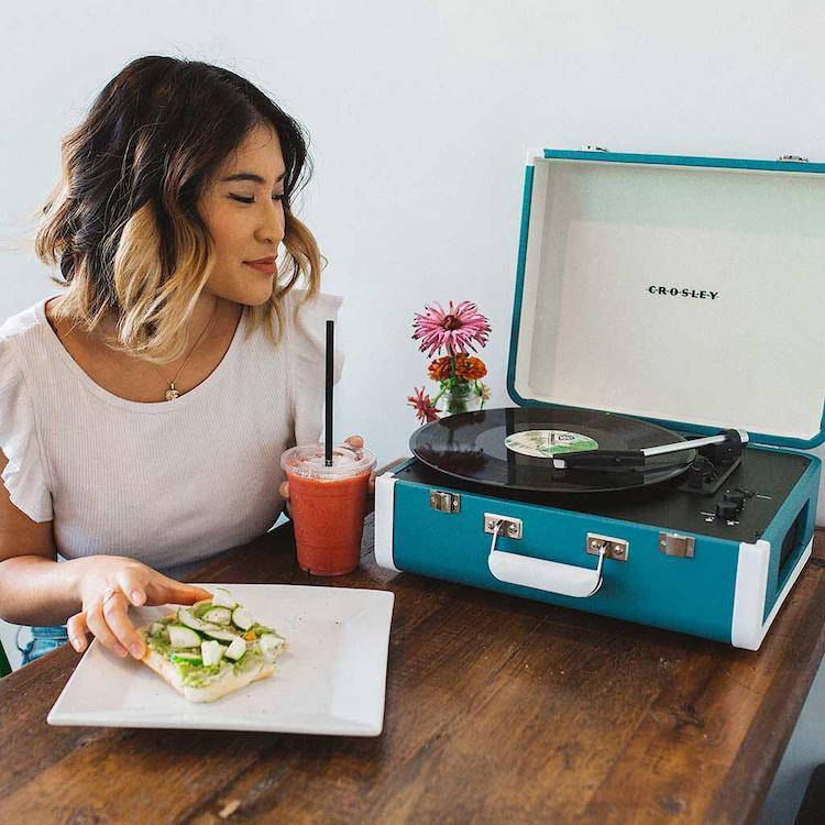 Woman with the Crosley Cruiser vinyl record player