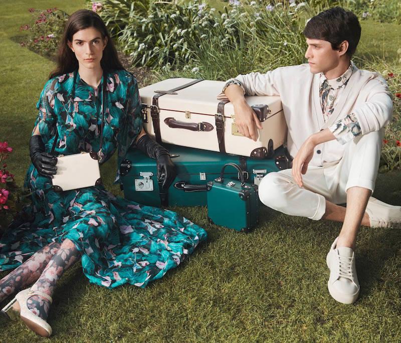 Couple with luxury brand suitcases