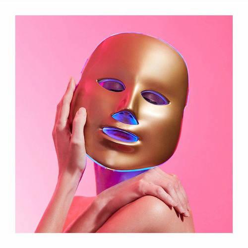 Person wearing MZ Skin golden facial treatment mask