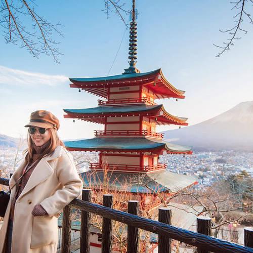 Woman at Chureito Pagoda overlooking Mount Fuji