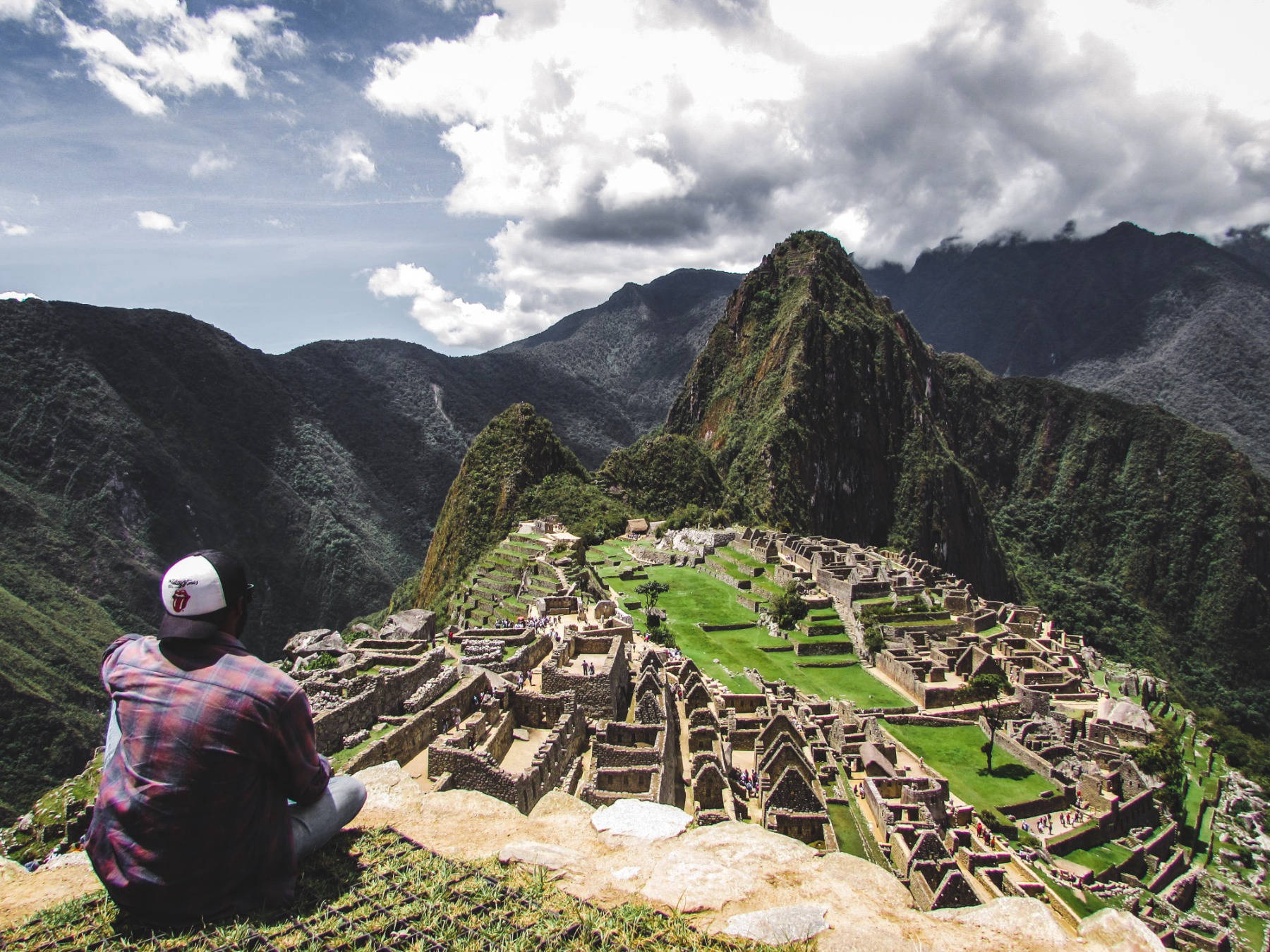 Man looking out over Machu Piccu