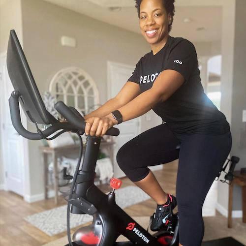 Woman on Peloton bike