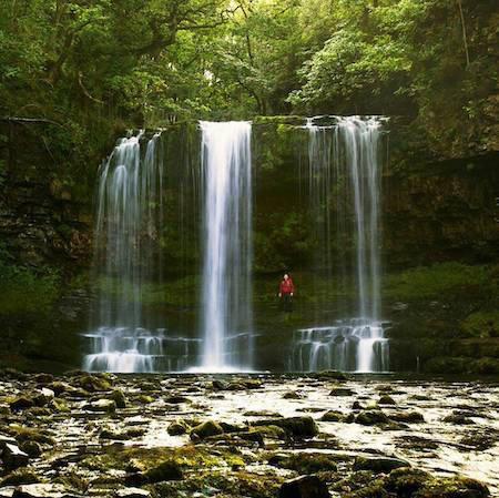 Person hiking around waterfalls