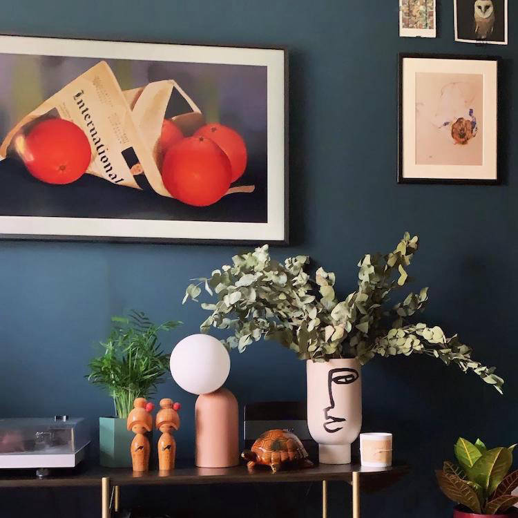 Plants and homewares on shelf