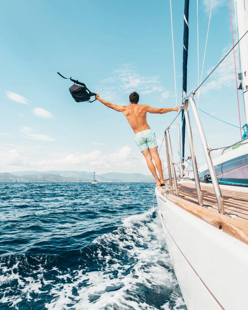 Man on a yacht on blue waters