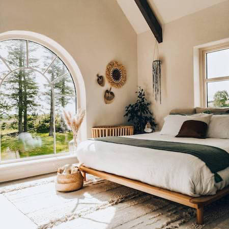 Airy bedroom with large window
