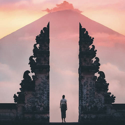 Person between  Candi Bentar gates in Indonesia