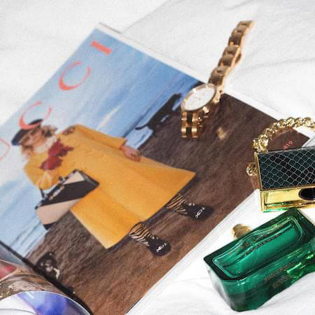 Gucci magazine on a table with accessories