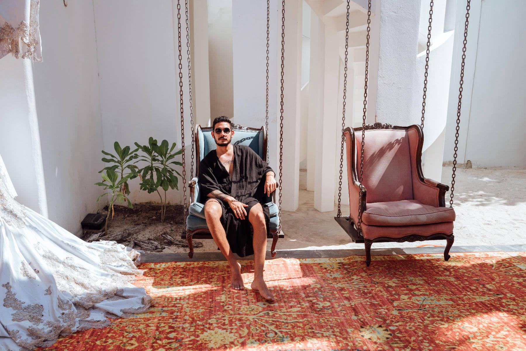 Man in armchair on sunny patio