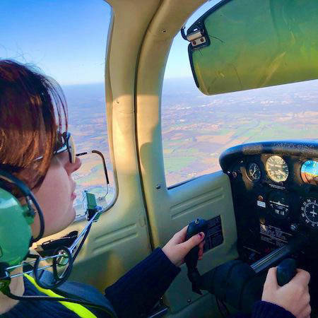 Person learning to pilot a plane