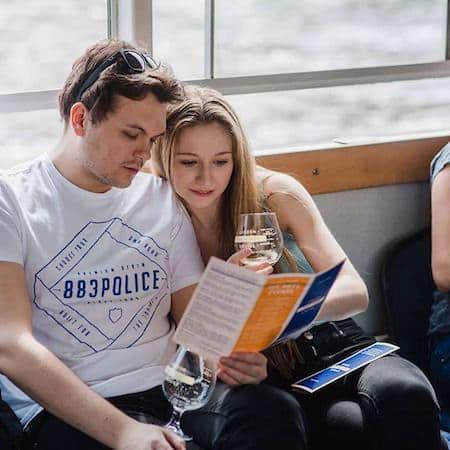 Couple looking at a craft beer menu