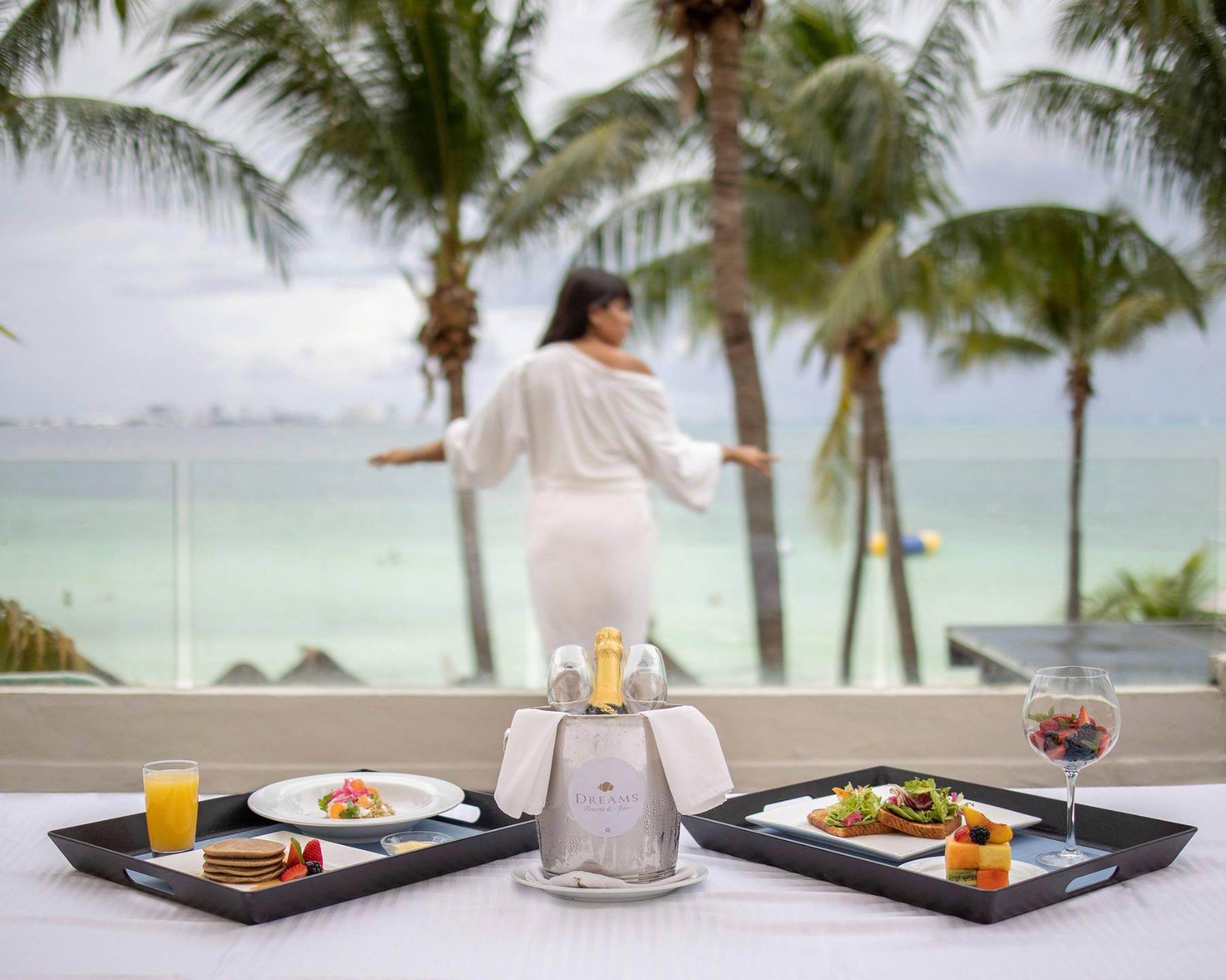 Woman at breakfast overlooking the sea