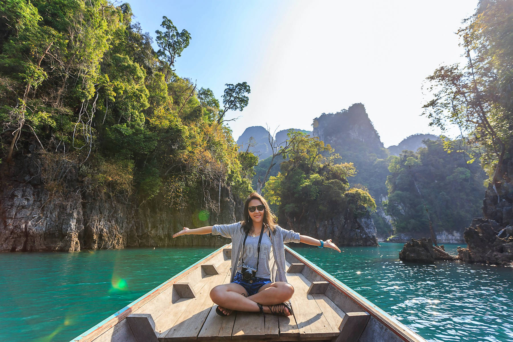 Woman on boat on river in Asia