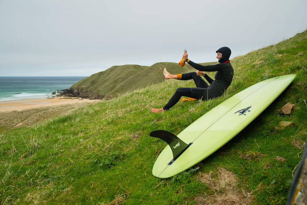 Person on hill with surf board