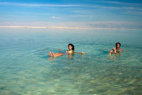 women swimming in dead sea