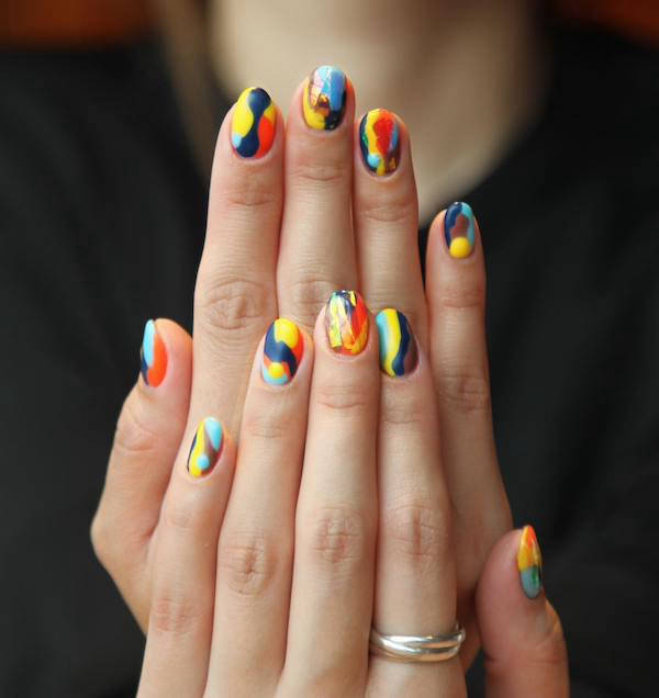 Hands with colourfully-painted nails