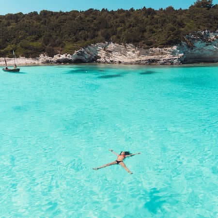Floating in crystal clear blue water