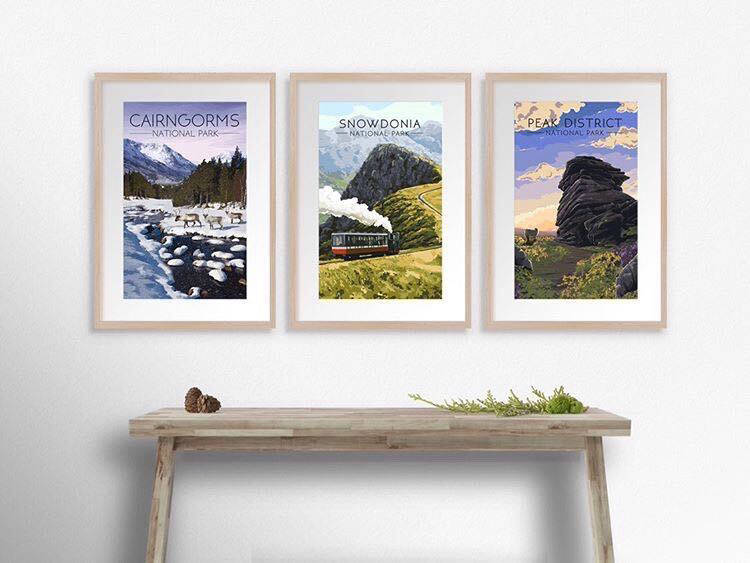 Three travel posters hanging on the wall