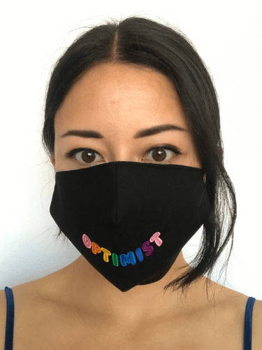 Woman with black Birdsong Optimist face mask