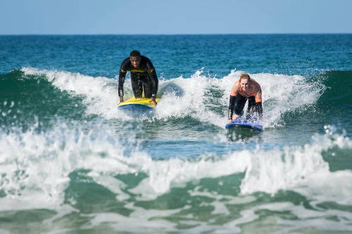 people surfing in cornwall