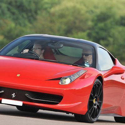 Red Ferrari on a racetrack