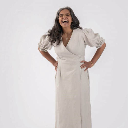 Woman laughing wearing white dress