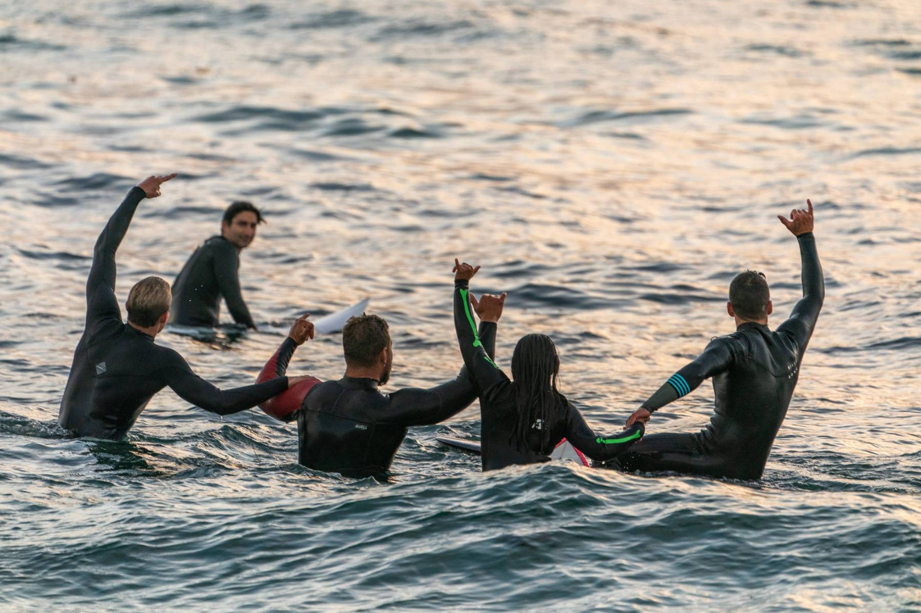 Surfing group in the water