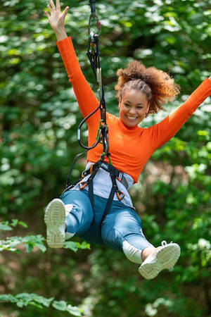 Person swinging on zip line
